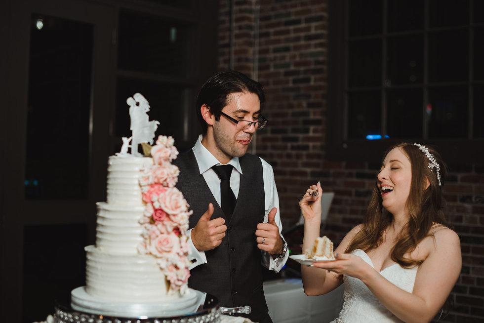 Bride and groom enjoying their wedding cake at Steam Whistle Brewing