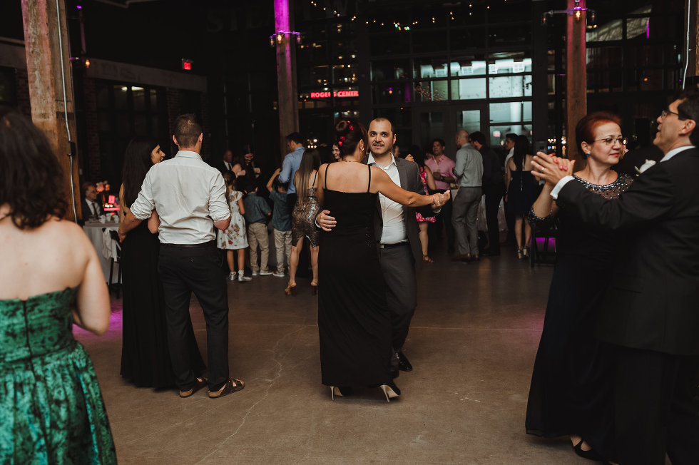 wedding guests slow dancing during wedding at Steam Whistle Brewing Toronto Canada