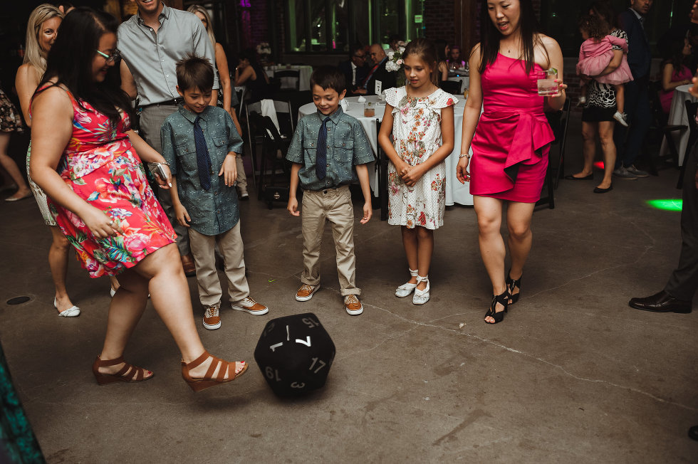 wedding guests kicking around oversized dice at Steam Whistle Brewing