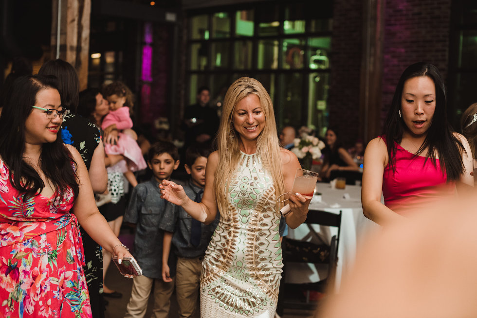 wedding guests dancing during wedding at Steam Whistle Brewing Toronto Canada