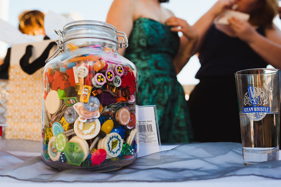 pint of Steam Whistle Pilsner beside jar of game pieces Toronto wedding photography