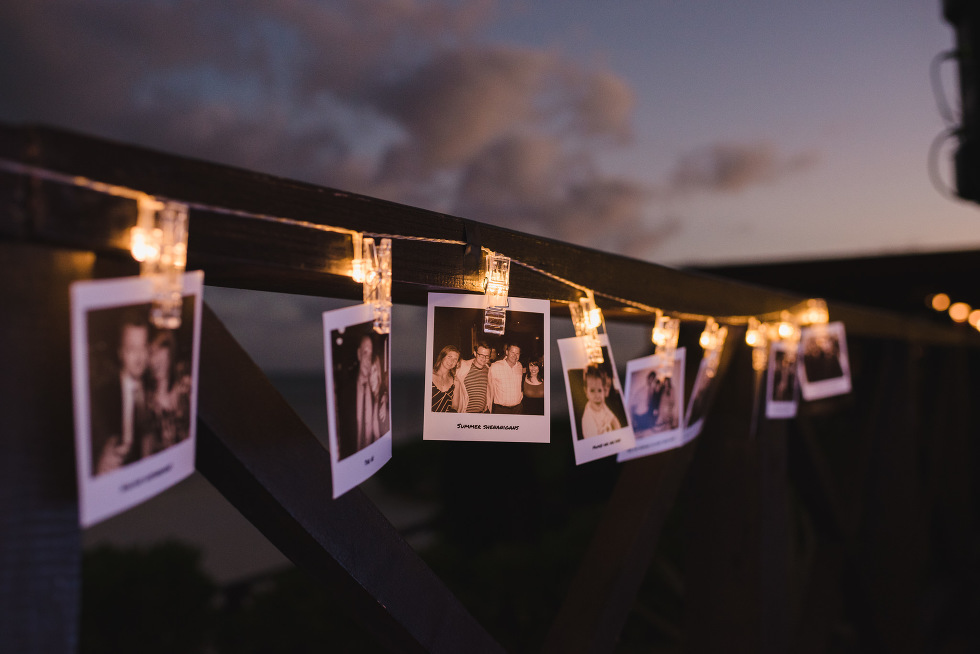 polaroids and lights strung up for wedding reception at Now Sapphire Resort in Mexico