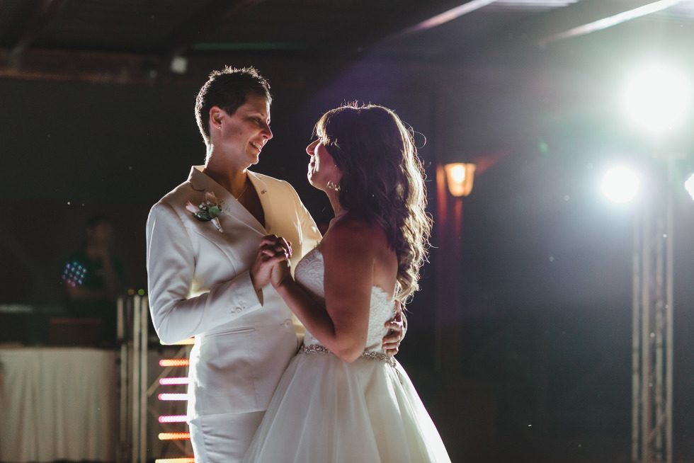brides share their first dance during wedding reception at Now Sapphire Resort in Mexico