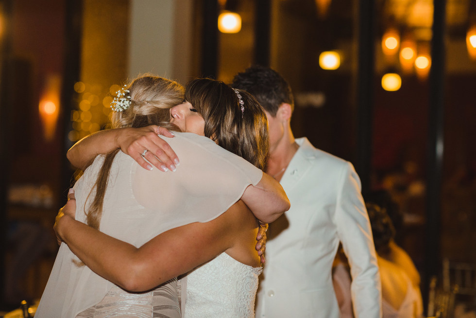 bride hugs a wedding guest during reception at Now Sapphire Resort in Mexico