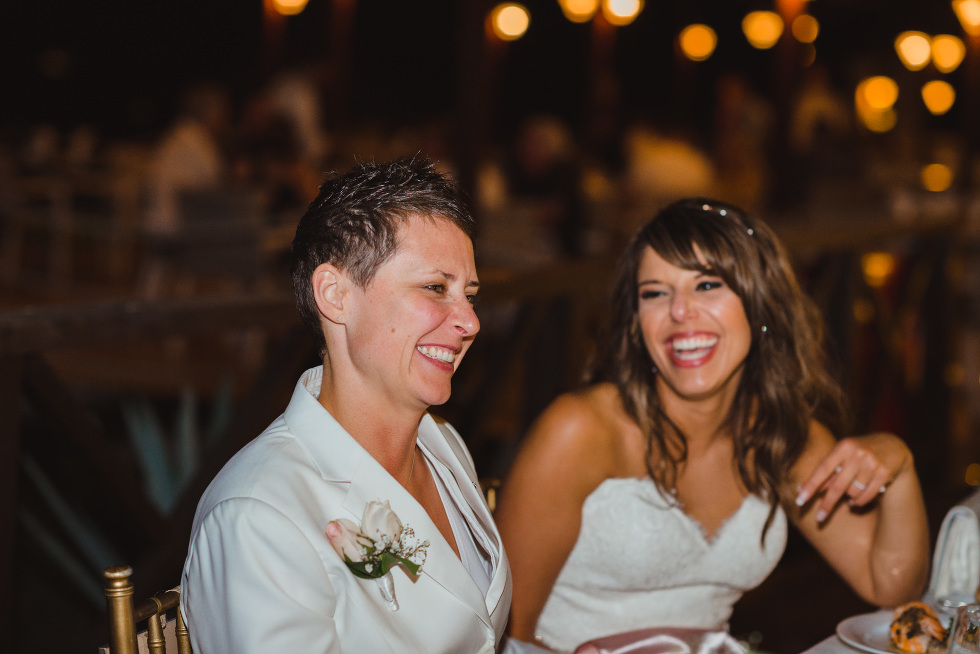 brides laughing during wedding reception at Now Sapphire Resort in Mexico