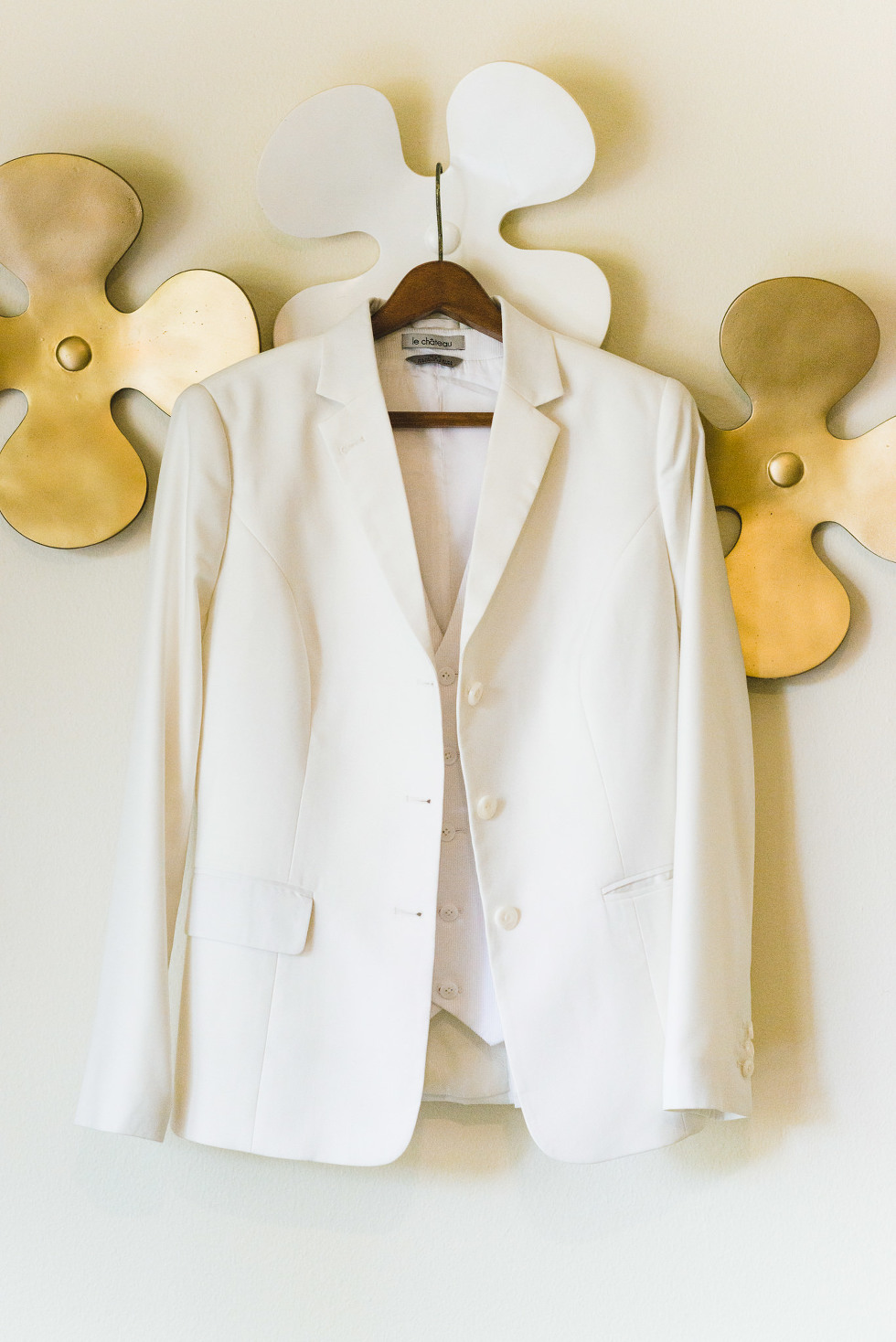 brides white wedding jacket hanging up on the wall at Now Sapphire Resort in Mexico