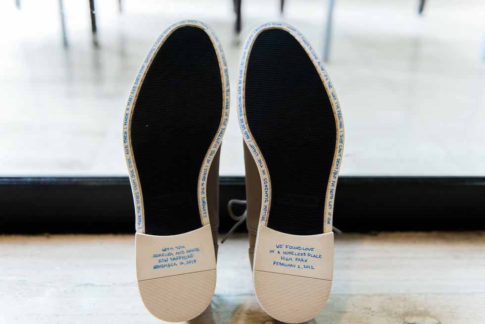 brides wedding shoes with blue writing on the bottom with personalized messages ahead of their destination wedding at Now Sapphire Resort in Mexico