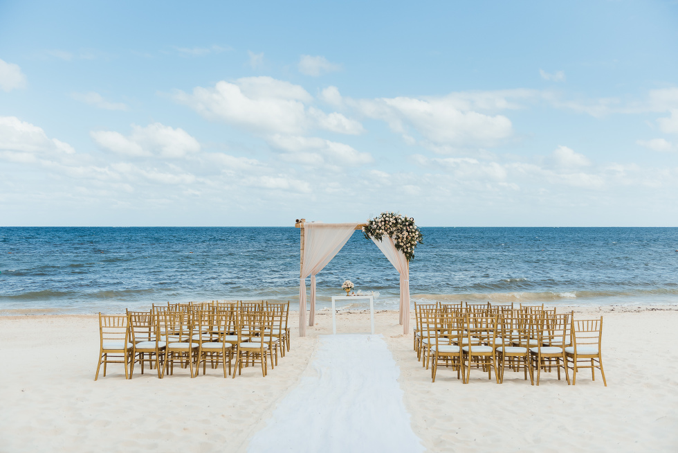 chairs and wedding alter set up on beach in front of the ocean at the Now Sapphire Resort in Mexico how to be really relaxed during your wedding