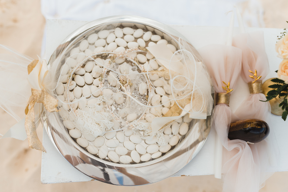 silver bowl filled with white candies at the entrance to wedding ceremony on the beach at Now Sapphire Resort in Mexico