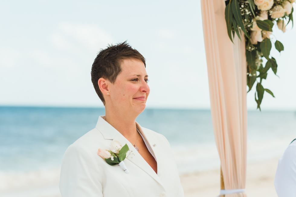 bride smiling and crying at beach wedding ceremony at Now Sapphire Resort in Mexico