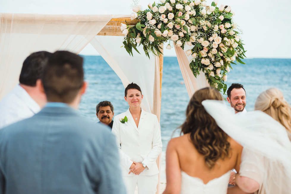 bride walking into wedding alter at a beach ceremony at Now Sapphire Resort in Mexico