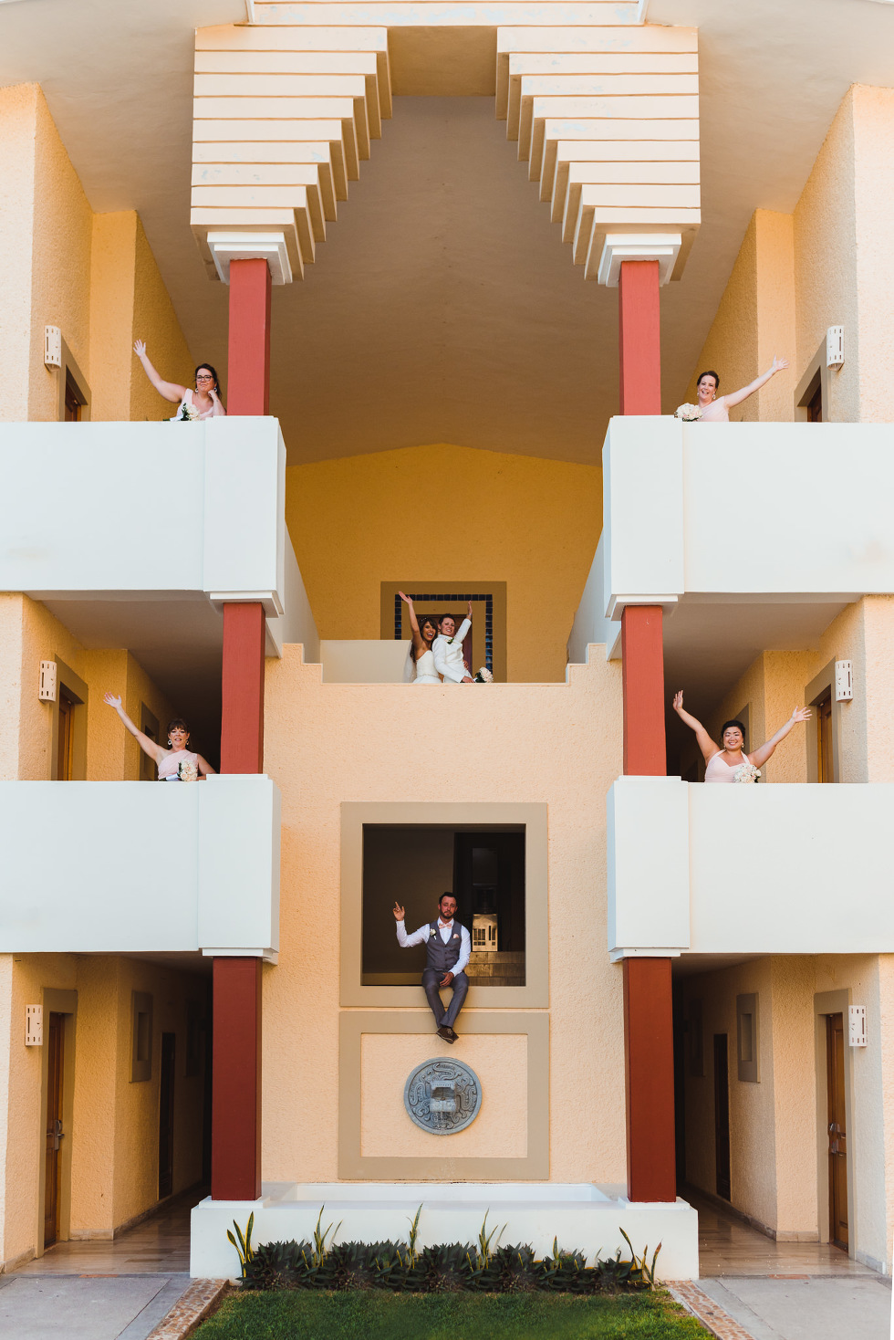 brides and wedding party standing in different balconies of Now Sapphire Resort Mexico how to be really relaxed during your wedding