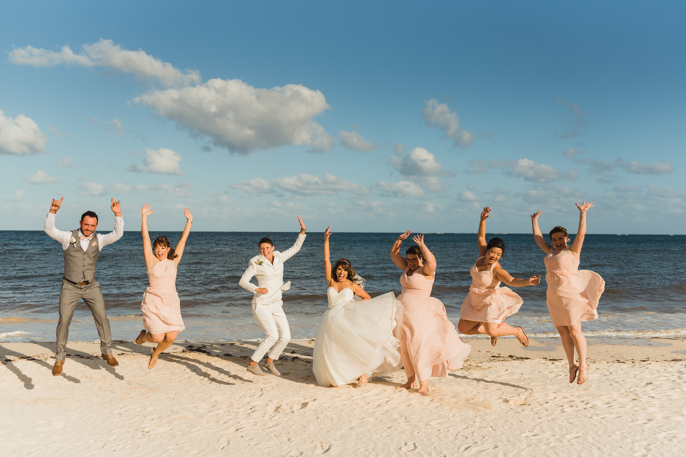 brides and their wedding party jumping in the air on the beach at the Now Sapphire Resort in Mexico how to be really relaxed during your wedding