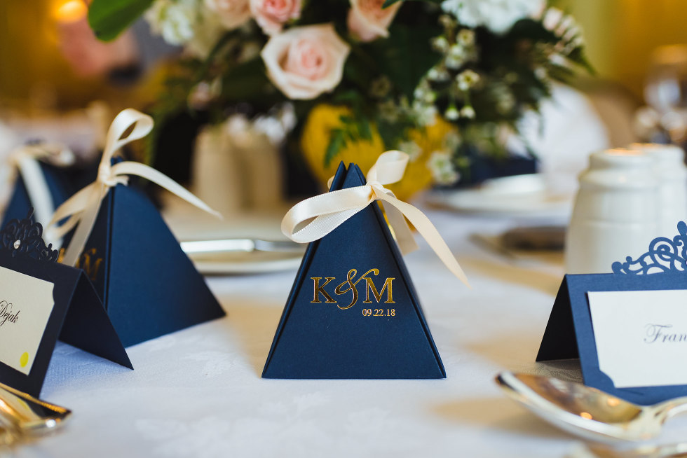 table setting with blue napkins and couple