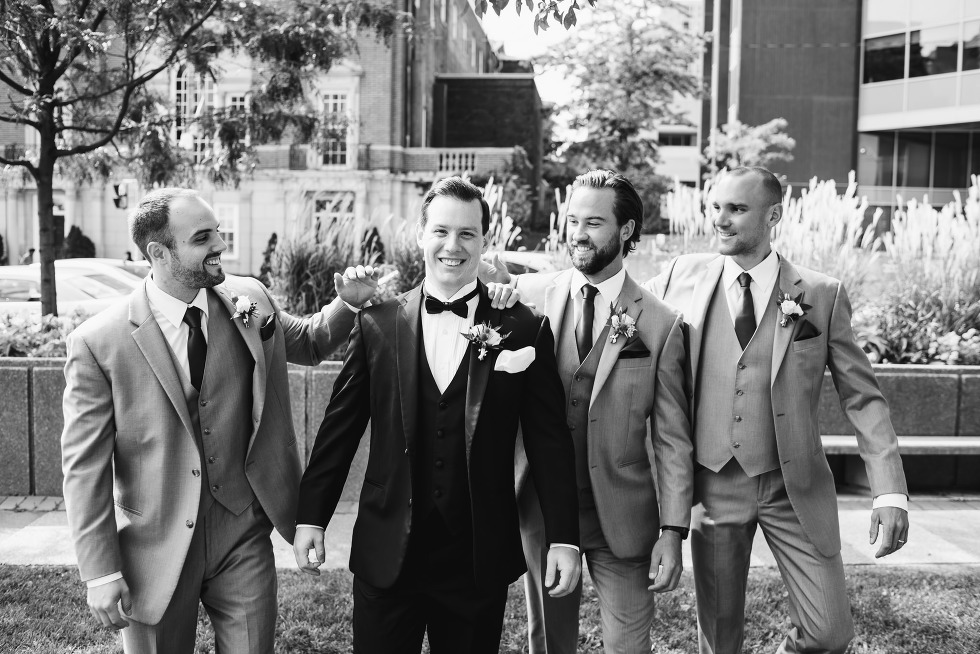 groom walking with his groomsmen before his amazing iconic downtown Toronto wedding