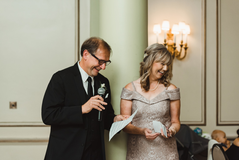 mother and father of the bride deliver speech during reception at the iconic University Club downtown Toronto wedding venue