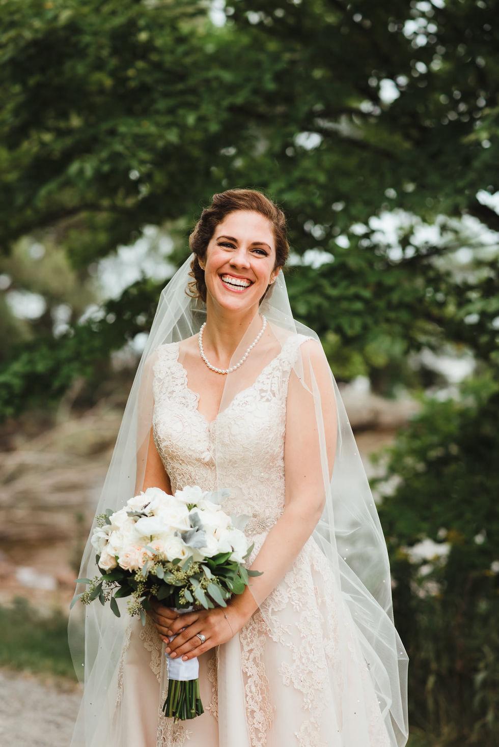 bride with huge smile after no first look wedding ceremony at La Paletta Mansion in Burlington Ontario