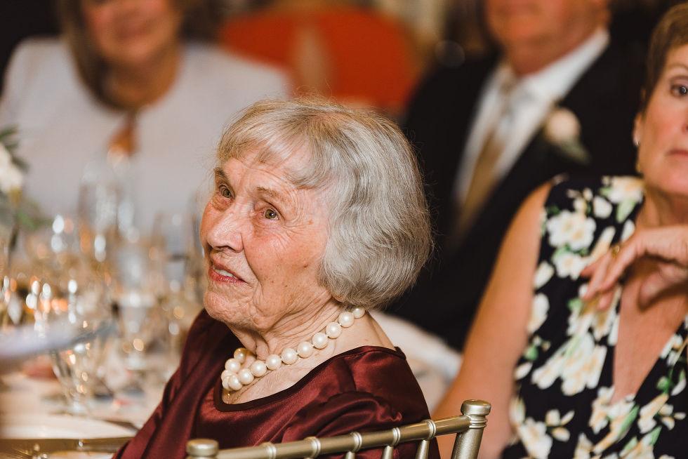 grandmother watching her grandchild