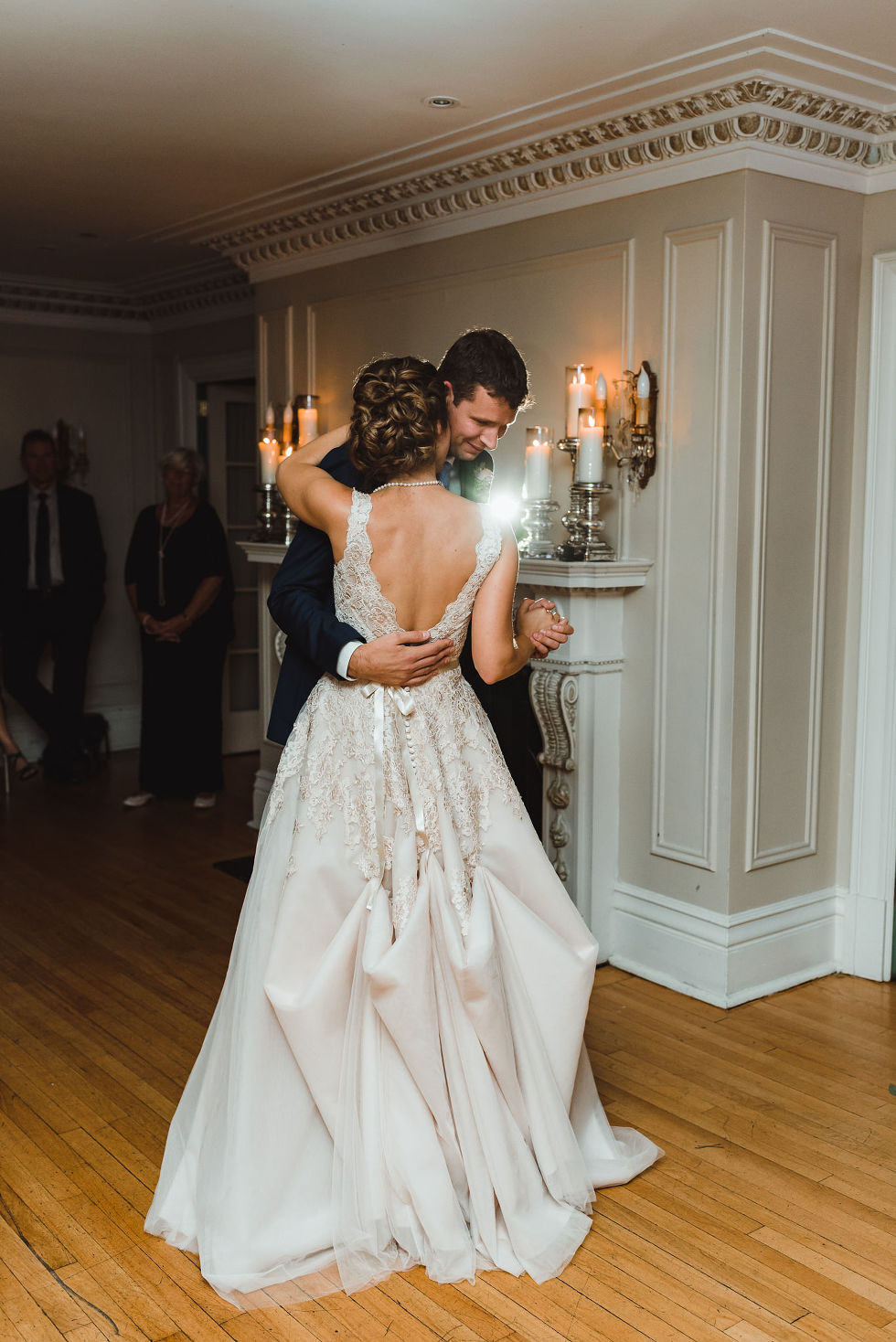 bride and groom sharing their first dance during wedding reception at La Paletta Mansion in Burlington Ontario