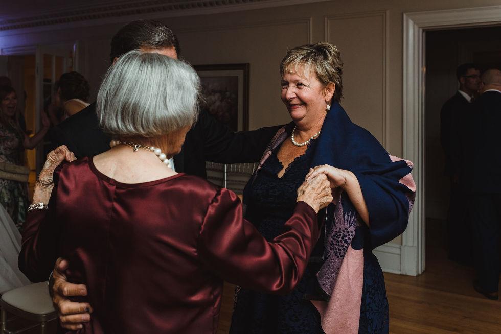 3 wedding guests sharing a dance during wedding reception at La Paletta Mansion in Burlington Ontario