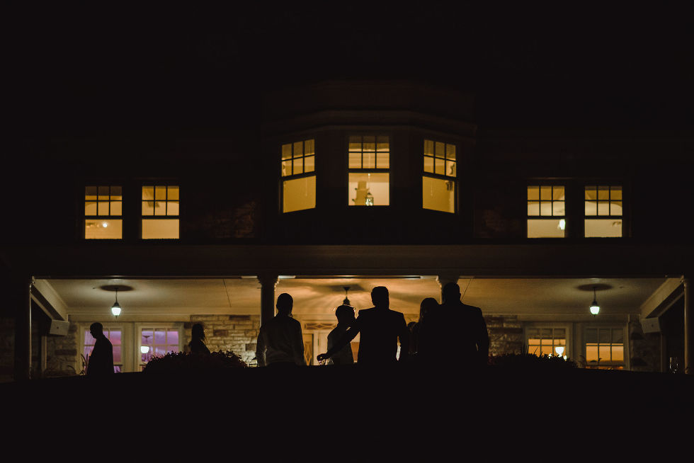 silhouette of wedding guests standing outside La Paletta Mansion in Burlington Ontario during a no first look wedding