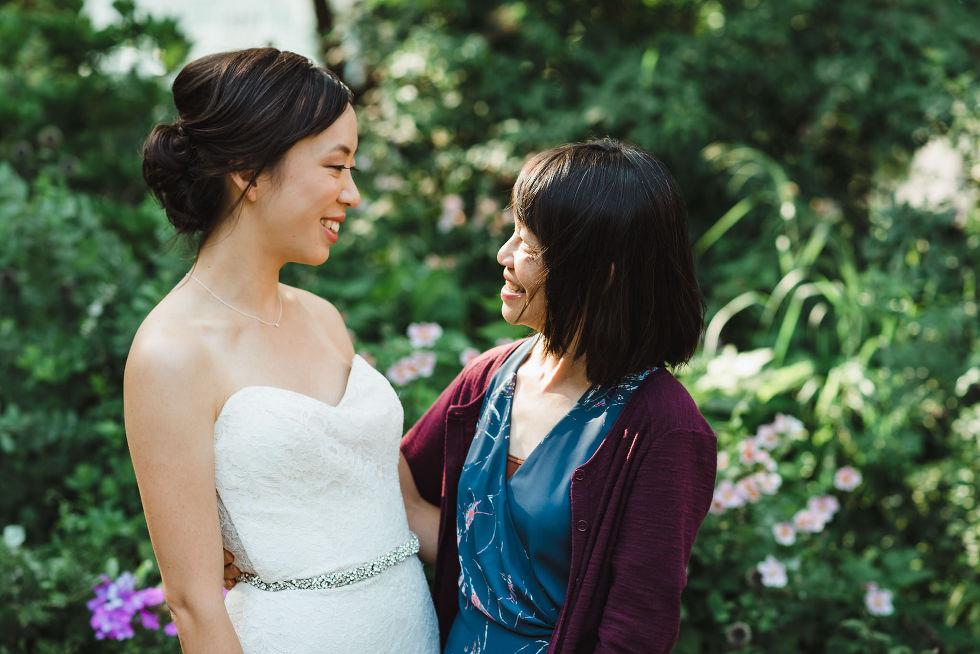 bride hugging her mother before Parisian inspired wedding at La Maquette in Toronto Ontario