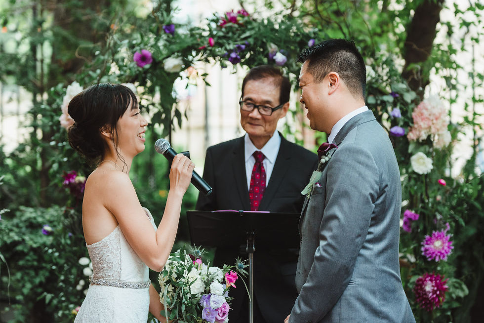 bride reading her vows to the groom with a microphone during their Parisian inspired wedding at La Maquette in Toronto Ontario