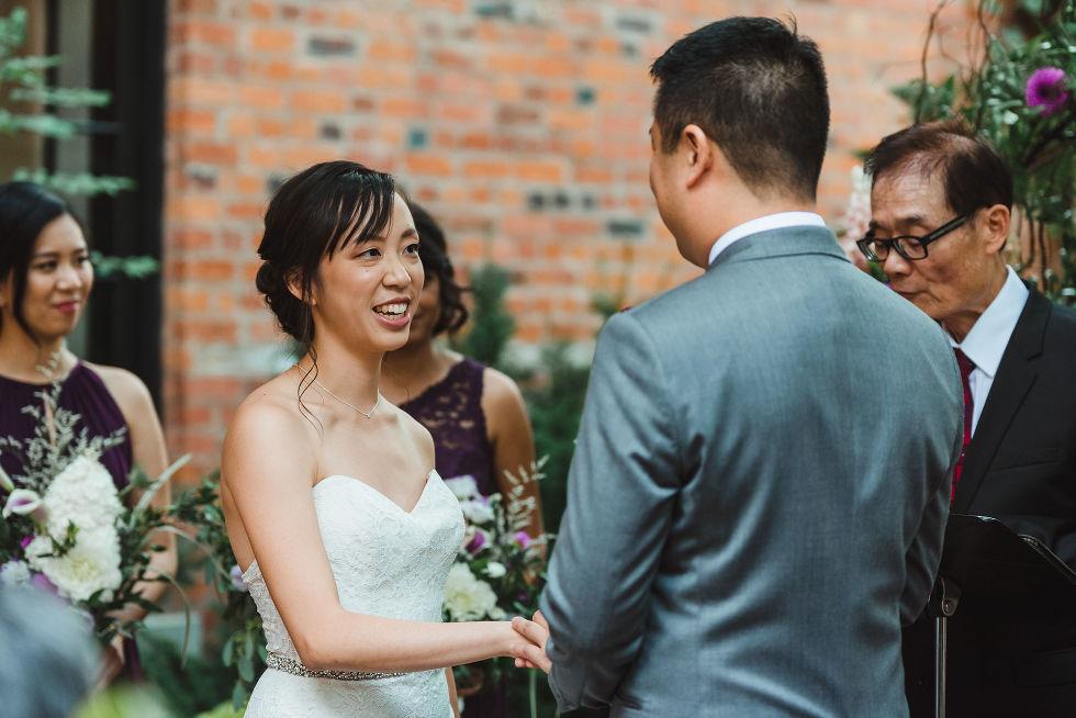 Bride smiling during her Parisian inspired wedding ceremony in Toronto Ontario at La Maquette