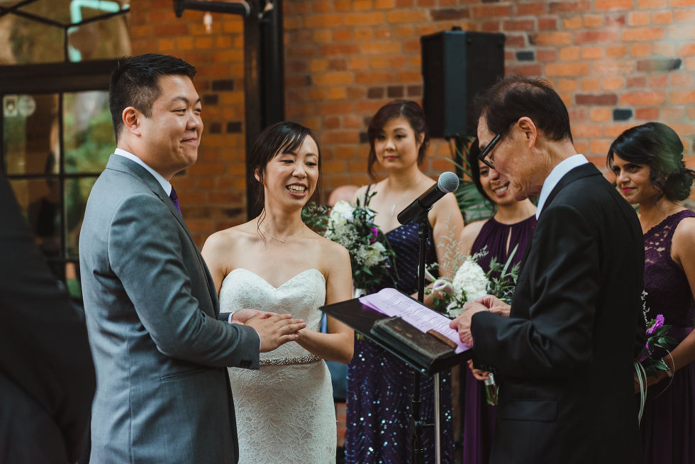 officiant performing ceremony for a bride and groom during their Parisian inspired wedding in Toronto Ontario at La Maquette