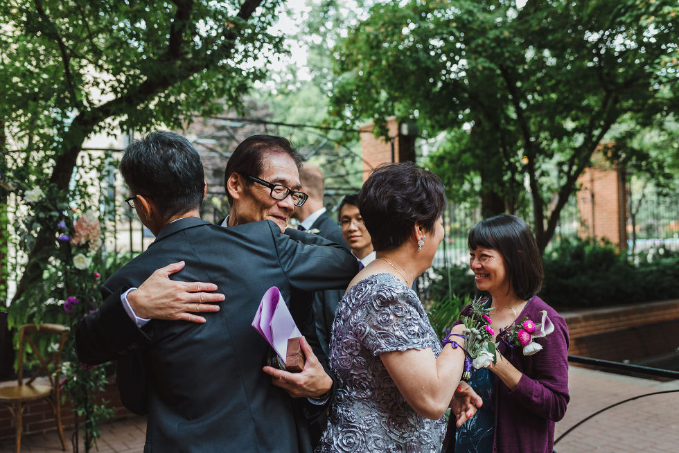 father of the bride hugging the officiant after the Parisian inspired wedding ceremony at La Maquette in Toronto Ontario