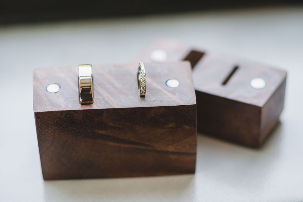 diamond wedding ring and gold wedding band in wooden box Parisian inspired wedding in downtown Toronto La Maquette