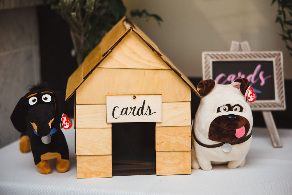 """stuffed animal dogs on a table beside a mini doghouse that reads """"cards"""" during Parisian inspired wedding at La Maquette in Toronto Ontario"""