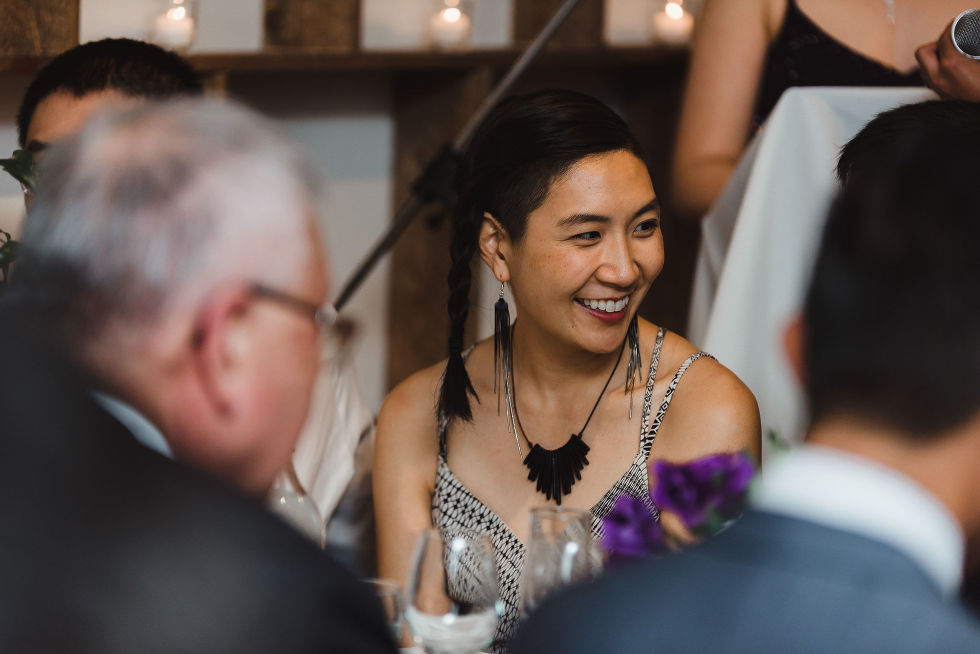 wedding guest smiling during a Parisian inspired wedding at La Maquette in Toronto Ontario