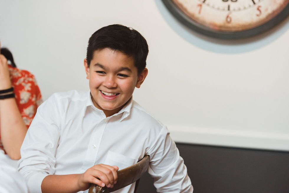 young wedding guest smiling during a Parisian inspired wedding at La Maquette in Toronto Ontario