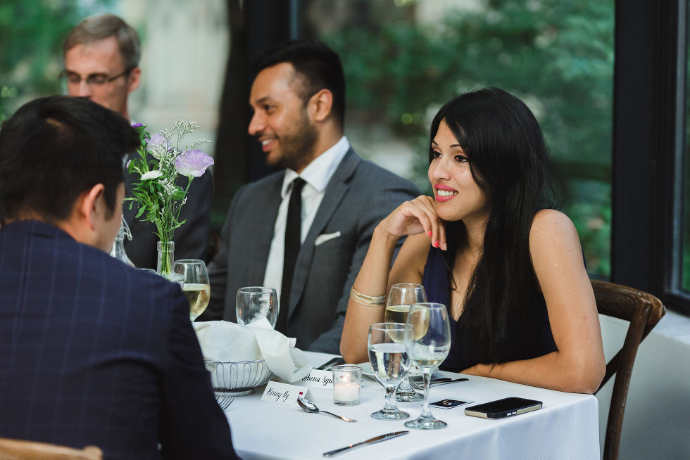 wedding guests chatting at their table during a Parisian inspired wedding at La Maquette in Toronto Ontario