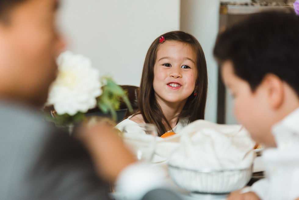 young girl smiling during a Parisian inspired wedding at La Maquette in Toronto Ontario