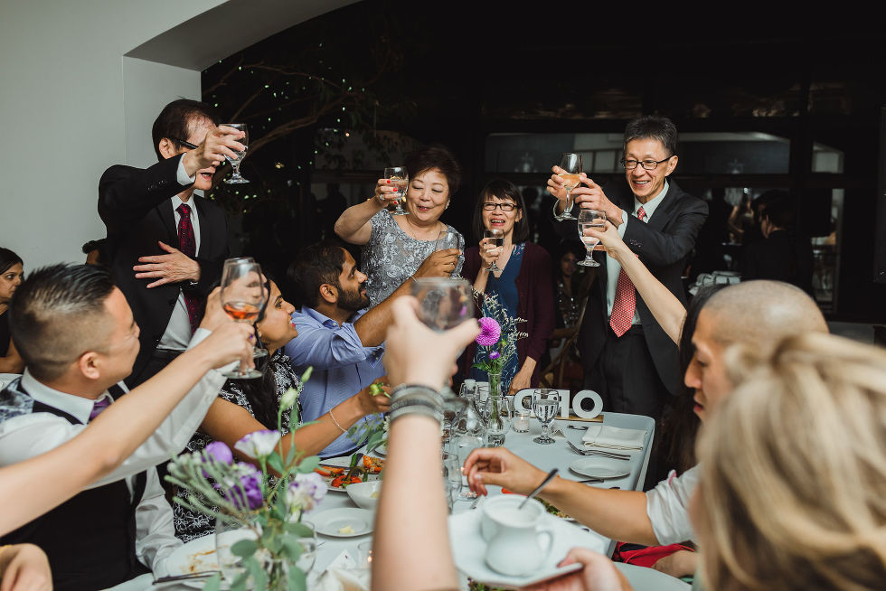 wedding guests giving a toast during a Parisian inspired wedding at La Maquette in Toronto Ontario