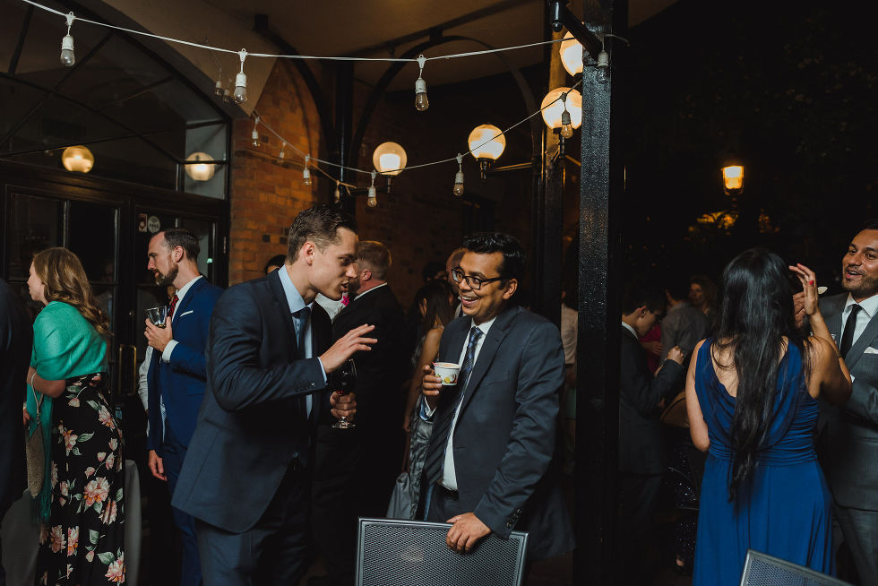 wedding guests mingling during a Parisian inspired wedding at La Maquette in Toronto Ontario