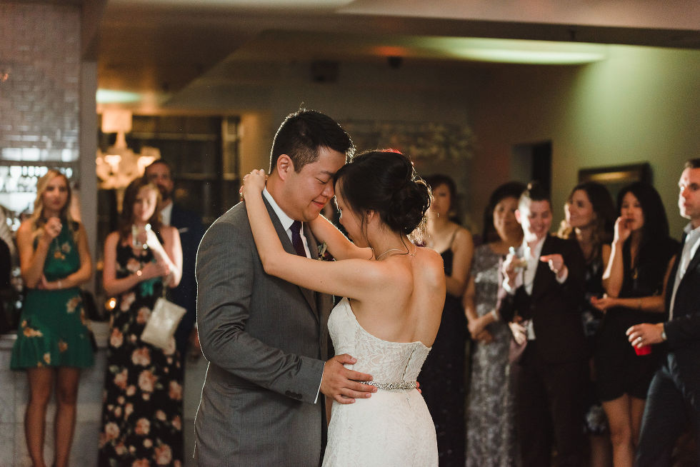 bride and groom slow dance while surrounded by wedding guests during their Parisian inspired wedding at La Maquette in Toronto Ontario