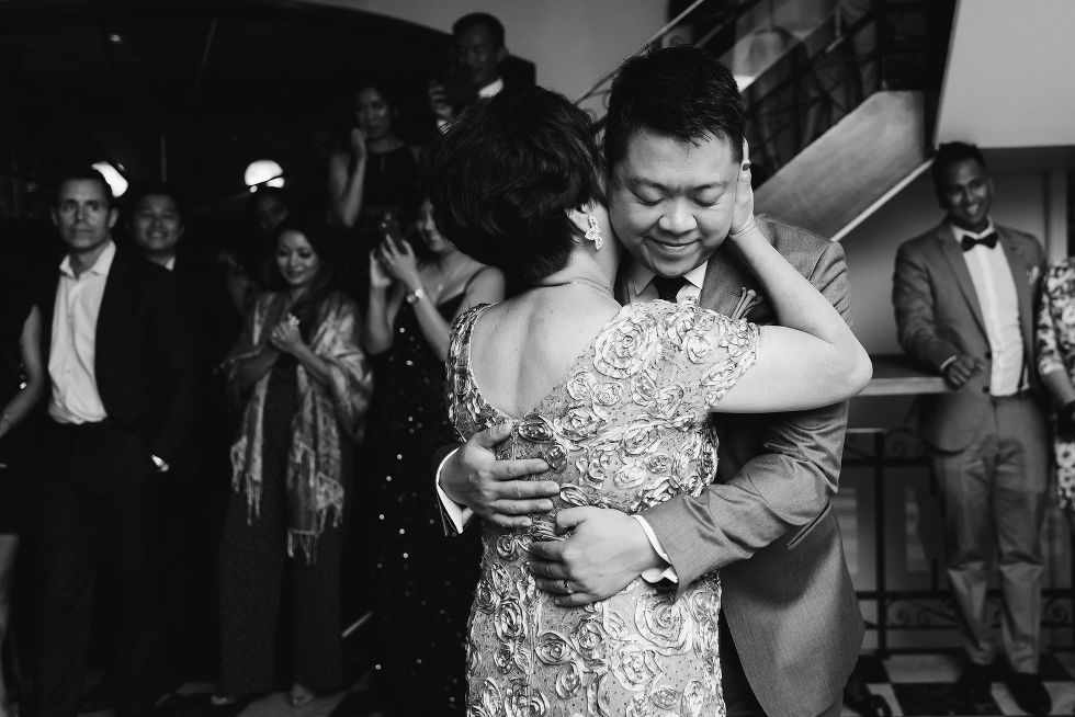 grooms mother hugging him during his Parisian inspired wedding at La Maquette in Toronto Ontario