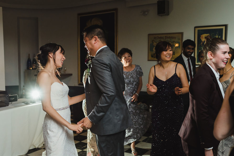 bride and groom dance alongside their wedding guests during their Parisian inspired wedding at La Maquette in Toronto Ontario