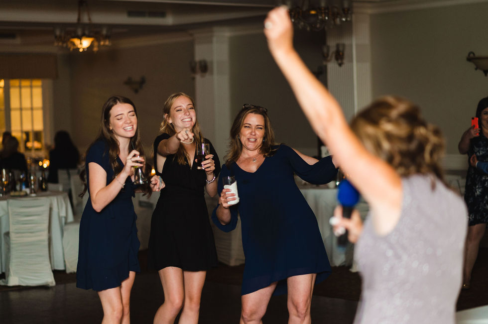 wedding guests having fun on the dance floor during a special wedding at the Royal Ashburn in Pickering