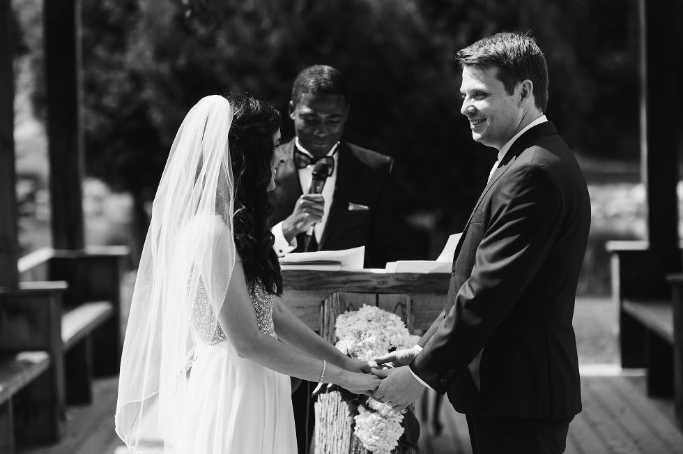 bride and groom holding hands while they read their vows aloud during their special wedding ceremony at Carvers cottage in Pickering