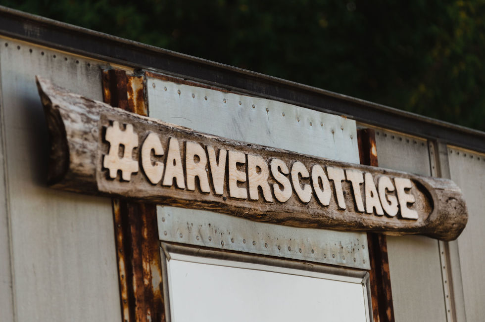 "A wooden sign reading ""CARVERSCOTTAGE"" on sheet metal backing Toronto wedding photography"