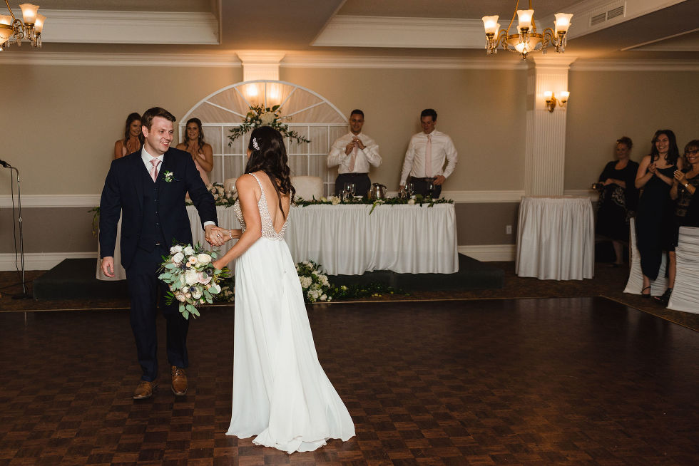 bride and groom share a dance during their special wedding reception at the Royal Ashburn in Pickering