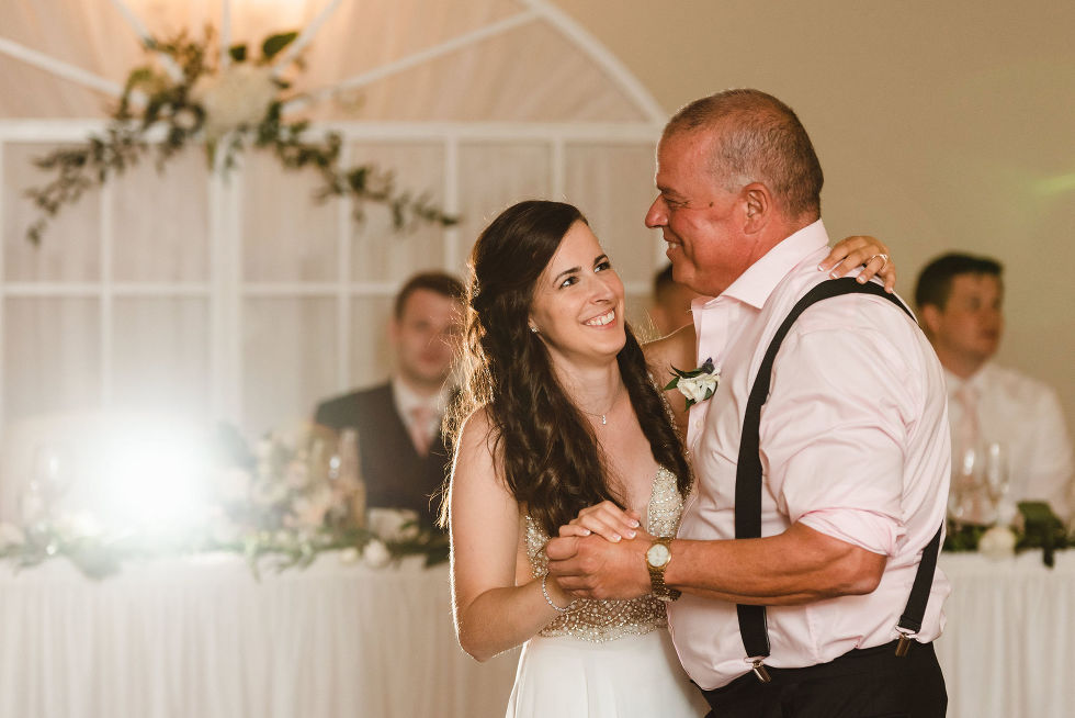 father of the bride dancing with his daughter on the dance floor during her special wedding at the Royal Ashburn in Pickering