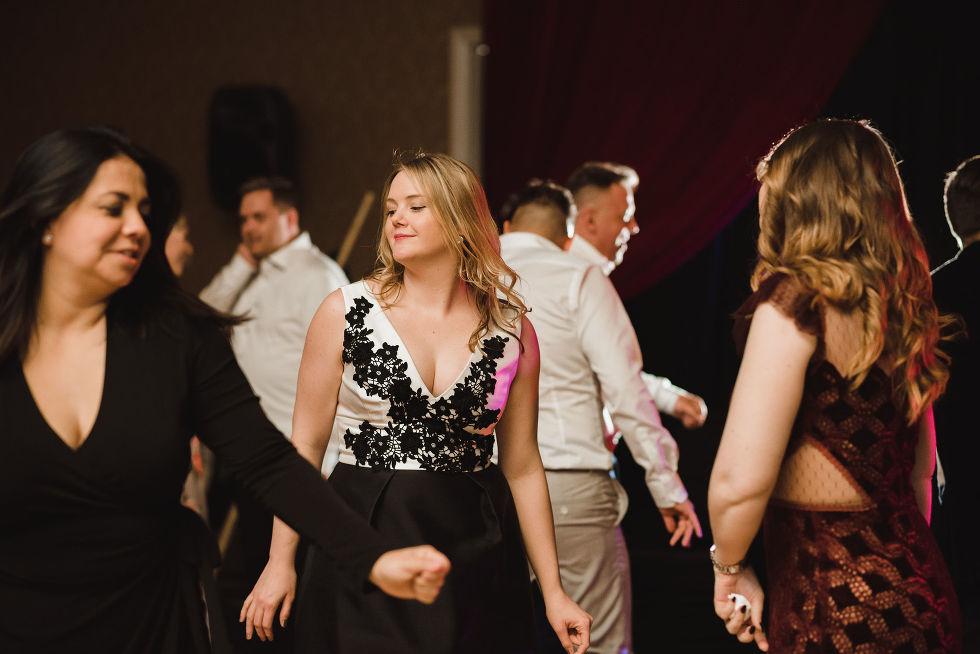 wedding guests dancing and having fun during a wedding reception at the Hilton Fallsview in Niagara Falls