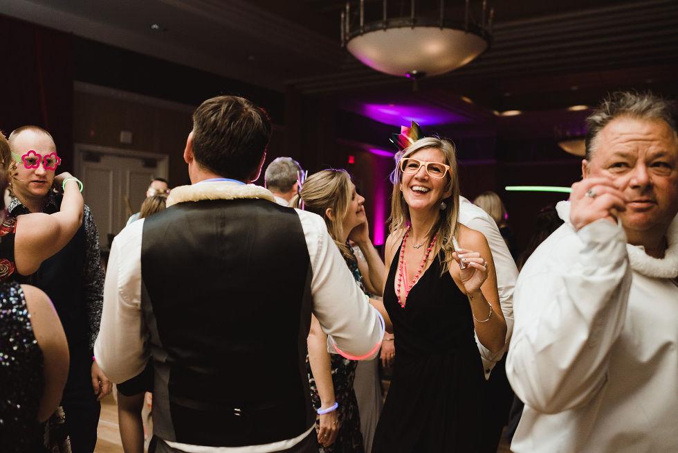 wedding guests dancing and laughing during a fun wedding at the Hilton Fallsview in Niagara Falls