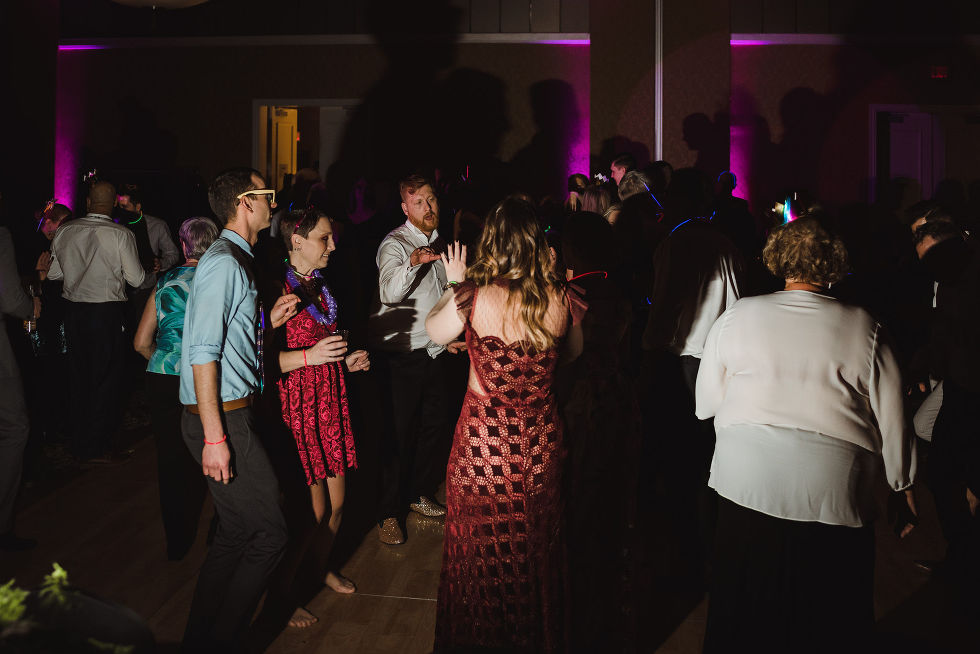 groom and his wedding guests dancing and laughing during a fun wedding at the Hilton Fallsview in Niagara Falls