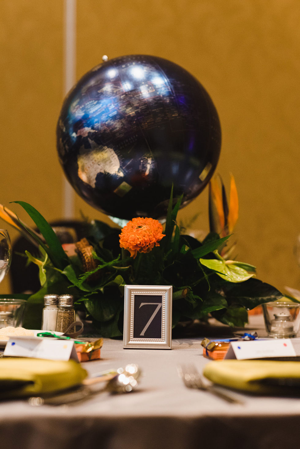 table setting with a globe centrepiece and the number 7 sign for a wedding at the Hilton Fallsview in Niagara Falls